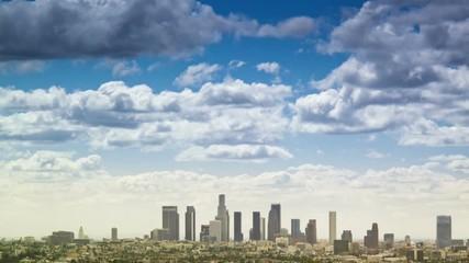 Fotobehang - City Los Angeles downtown skyline timelapse cityscape clouds blue sky background