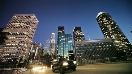 Fotobehang - Downtown Los Angeles skyline and traffic at dusk. Wide angle view. Timelapse.