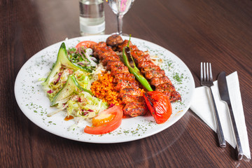 Adana kebap with rice and vegetables