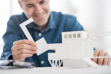 Architect assembling an architectural model