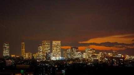 Fotobehang - Sunset over Century City skyline, Los Angeles. Dusk to night transition.