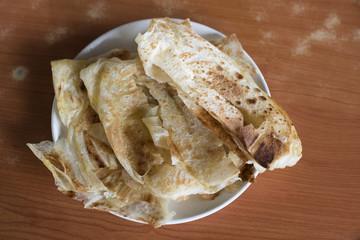 flatbrea on a table. malaysian famous meal called ROTI CANAI
