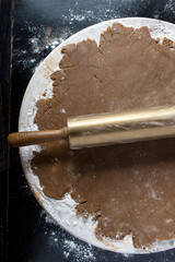 rolled out gingerbread dough on round marble top view