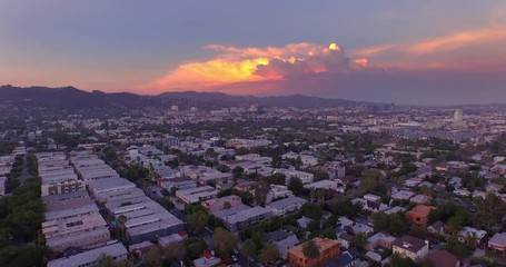 Fotobehang - Aerial view city of Los Angeles, West Hollywood sunset camera flying forward 4K