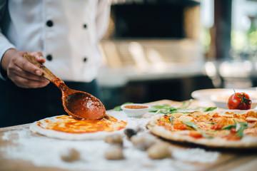 Fresh Italian pizza making process.