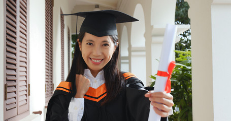 Woman get graduation hold with paper certificate