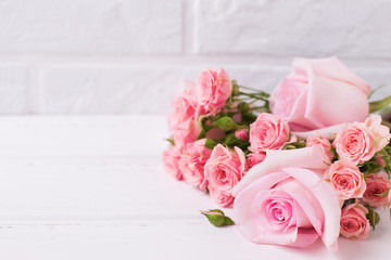 Tender pink roses flowers  on  white wooden background.