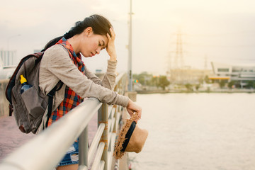 Asian women unhappy and tired during backpacker on vacation hipster lifestyle, color style vintage tone