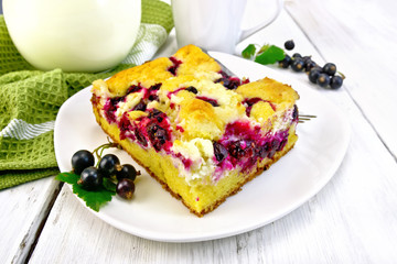 Pie with black currant in plate on light board