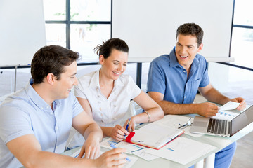Group of happy young business people in a meeting