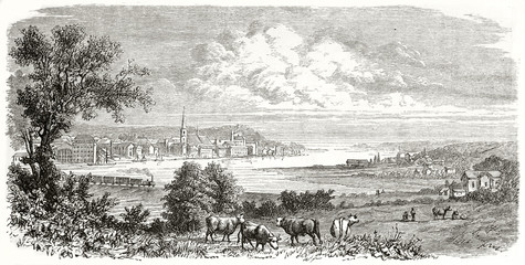 Ancient view of a little city from the coutry all around. Railroad, and grazing cows on foregrownd. Kiel northern Germany. Created by Guaiaud published on Le Tour du Monde Paris 1862
