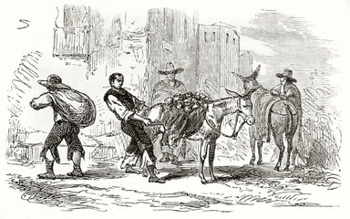 Vintage rough style illustration of mexican merchants that upload goods on their mules. Mexican muleteer. Created by Riou and Salandre published on Le Tour du Monde Paris 1862