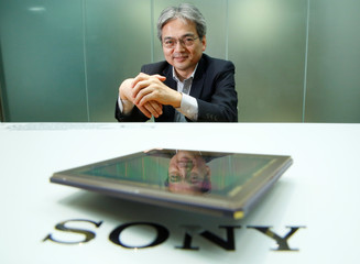 Hirayama, technology chief of Sony's chip business, poses for a photo as he is reflected on a Sony's image sensor after an interview with Reuters in Tokyo