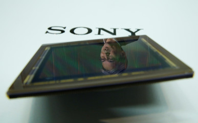 Hirayama, technology chief of Sony's chip business, is reflected on a Sony's image sensor during an interview with Reuters in Tokyo