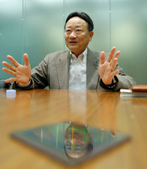Shimizu, chief of Sony's chip division, is reflected on a Sony's image sensors during an interview with Reuters in Tokyo