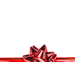 Red bow and ribbon isolated on white background. A holiday symbol, an element of decor.
