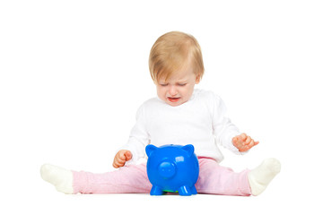 Caucasian baby girl with piggy bank isolated on white background