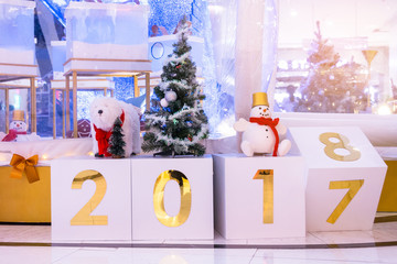 Calendar change to 2018..Atmospheric Christmas and new year decoration. Lights and lighted ornaments glowing in the night, house yard covered with snow.