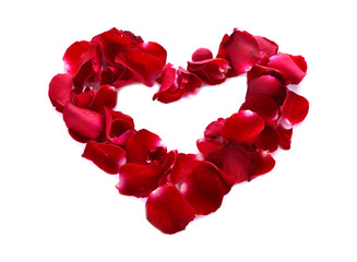 A red heart is formed by rose petals.