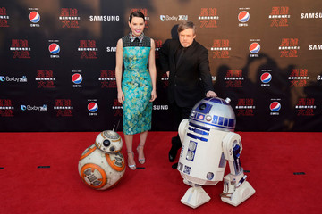 Actors Daisy Ridley and Mark Hamill pose for pictures as they arrive for the China premiere of 'Star Wars: The Last Jedi', at the Shanghai Disney Resort in Shanghai