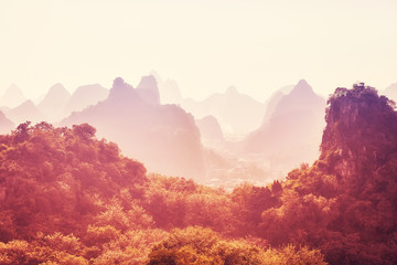 Karst mountainous landscape at sunrise, color toned picture, Guilin, China.