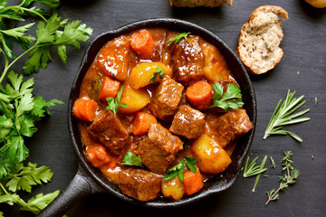 Beef stew, goulash in cast iron pan