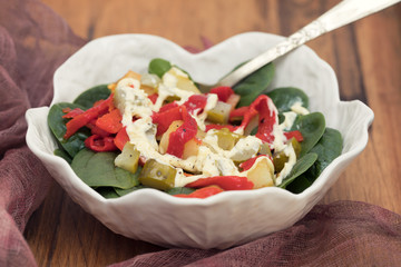 warm salad with potato , salted cucumber and red pepper