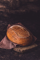 Rye bread on dark stone background closeup