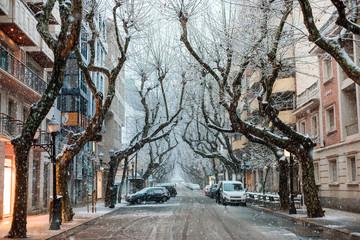 Snowfall in small spanish town Denia in winter