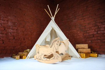 Small tepee in a kids  interior. wigwam in the studio