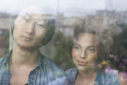 Close-up of couple seen through glass window