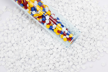 colorful industrial plastic pellet on white background.