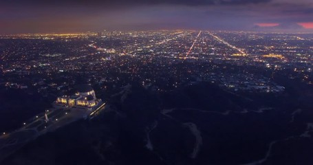 Fotobehang - Aerial view Los Angeles cityscape night Griffith Observatory foreground. 4K UHD
