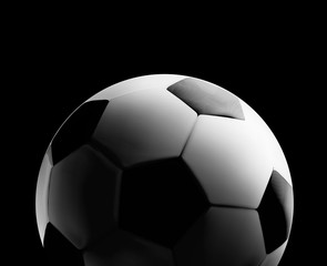 Soccer or football ball in the backlight on black background. close-up illustration