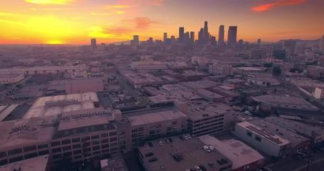 Fotobehang - Aerial view Los Angeles downtown skyline at sunset Camera flying backward 4K UHD