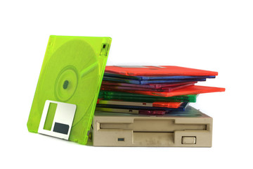 Floppy disk drive and diskettes on white background