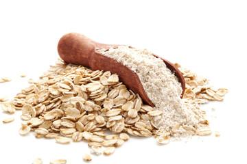 Pile of oat wholegrain flour in spoon
