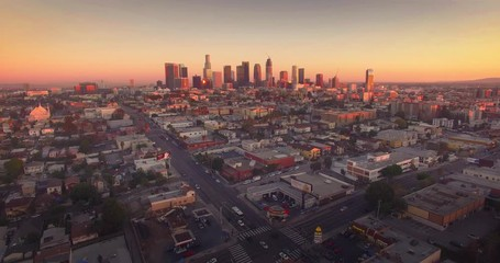 Fotobehang - Aerial view downtown Los Angeles cityscape skyline sunset camera flying forward