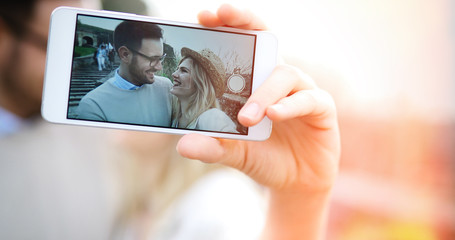 Happy couple having fun and taking a selfie