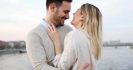 Happy couple in love hugging outdoor