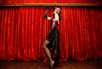 dancer in moulin rouge style is dancing on the stage