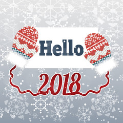 Text Hello 2018 on winter background with mittens