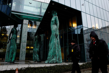 Security guard officers walk outside the Supreme and Appeal Court building in Warsaw