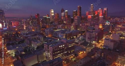 Fotobehang Aerial view illuminated city downtown Los Angeles skyline at dusk night. 4K UHD