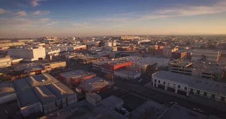 Fotobehang - Aerial view city Los Angeles downtown skyline sunset Camera rotating 4K UHD
