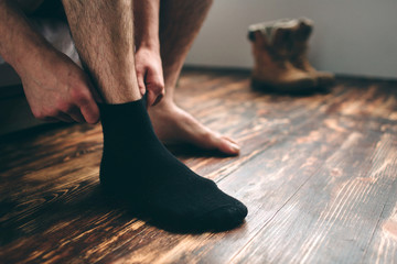 The man wears black socks. Men's style.