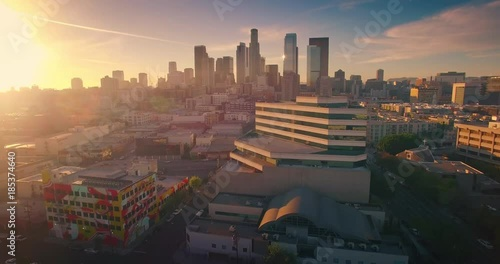 Fotobehang Aerial view city Los Angeles downtown skyline sunset Camera flying forward 4K