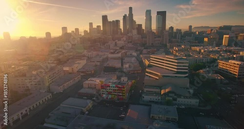 Fotobehang Aerial view city Los Angeles downtown skyline sunset Camera panning sideways 4K