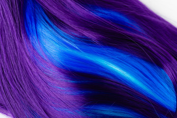 Closeup of colorful hair in purple and turquoise blue colors