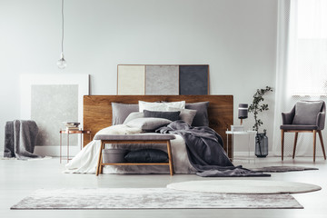 Grey bedroom with simple painting